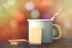 Hot cup of coffee and classic cookie Royalty Free Stock Image