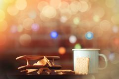 Hot cup of coffee, cookie and wooden plane Royalty Free Stock Images