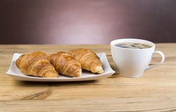 Hot cup of coffee with croissants in the restaurant Stock Image