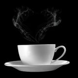 Hot Cup of Coffee  with heart shape smoke on Black Backgro Stock Photography
