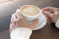 Hot cup of coffee latte Stock Photography