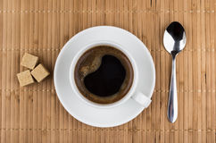 Hot cup of coffee, lumps of sugar and spoon Royalty Free Stock Images