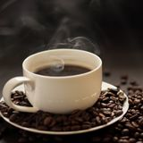 Hot cup of coffee with smoke. On black background Royalty Free Stock Images