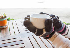 Hot cup of coffee in winter Royalty Free Stock Photo