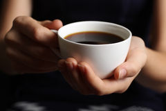 Hot cup of coffee in the women's hands Royalty Free Stock Photo