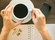 Hot cup of coffee on wooden work table Royalty Free Stock Photography