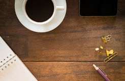 Hot cup of coffee on wooden work table Stock Photography
