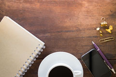 Hot cup of coffee on wooden work table Stock Image