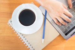 Hot Cup Of Coffee On Working Table Stock Photos