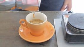 Hot cup of creama coffee by moka pot stock footage