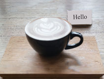 Hot cup of latte art coffee Royalty Free Stock Images