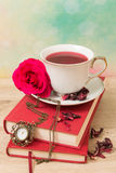 Hot cup of red tea  and books Stock Photo