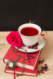 Hot cup of red tea  and books Stock Images