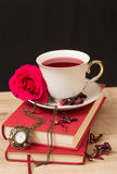 Hot cup of red tea  and books Royalty Free Stock Images
