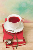 Hot cup of red tea  and books Stock Photography