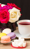 Hot cup of red tea and  colored cakes Stock Images