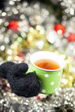 Hot cup of tea on Christmas Eve. Hot cup of tea on Christmas background Royalty Free Stock Image