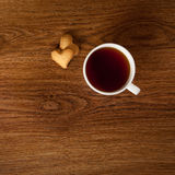 Hot cup of tea with cookies on wooden table Royalty Free Stock Photos