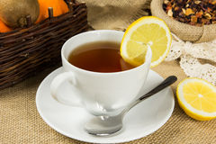 Hot cup of tea and dry herbal leaves Stock Photo