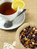 Hot cup of tea and dry herbal leaves Royalty Free Stock Photos