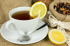 Hot cup of tea and dry herbal leaves Royalty Free Stock Photography