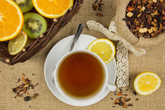 Hot cup of tea and fresh fruits Royalty Free Stock Photos