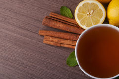 Hot cup of tea. And fresh lemons. Top view stock photography