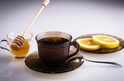 Hot cup of tea. Hot tea with honey and lemon slices Stock Photography