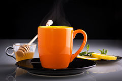 Hot cup of tea. Hot tea with honey, mint and lemon slices Royalty Free Stock Images