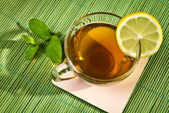Hot cup of tea with lemon Royalty Free Stock Image