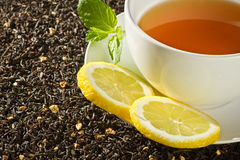 Hot cup of tea with lemon on grain Stock Photo