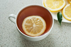 Hot cup of tea with lemon Stock Photo