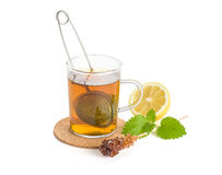 Hot cup of tea with lemon and melisse Royalty Free Stock Photography