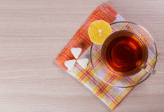 Hot cup of tea with a lemon on the table. Stock Images