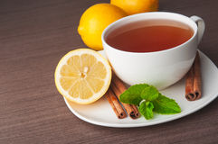Hot cup of tea. With lemons and mint stock images