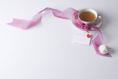 Hot cup of tea with love note and cookie Royalty Free Stock Images