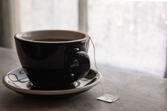 Hot cup of tea on a marble window sill in front of an Ice coated stock photo