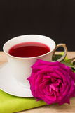 Hot cup of tea  and pink flower Royalty Free Stock Images