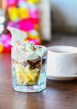 Fruit dessert with colorful sprinkles & cup of tea Royalty Free Stock Photography