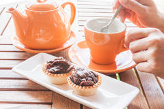Hot cup of white tea and crispy chocolate tarts Royalty Free Stock Photo