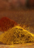 Hot curry powder in a pile flying away Royalty Free Stock Image
