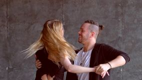 Hot dance two professional dancers. Young couple dancing zouk dance stock video footage