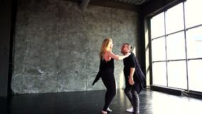Hot dance two professional dancers. Slow-motion. Young couple dancing zouk dance stock footage