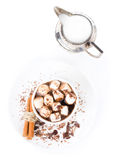 Hot dark chocolate with mini marshmallow, cinnamon and milk in a Royalty Free Stock Photo