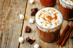 Hot dark chocolate with whipped cream, cinnamon and salted caram Royalty Free Stock Photography