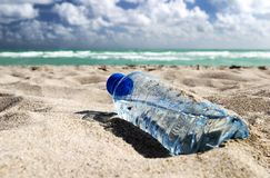 Hot day. Bottle of water on the beach Royalty Free Stock Photos
