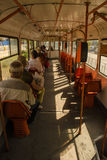 Hot day in the tram. People going to work with the tram in a hot summer day royalty free stock photo