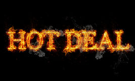 Hot deal burning word written text in flames. On black background Stock Photography