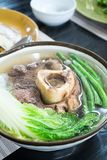 Beef bone marrow soup or also known as bulalo. Hot delicious beef bone marrow soup or also known as bulalo stock image