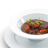 Hot delicious beef cooked in a red wine sauce Royalty Free Stock Photos